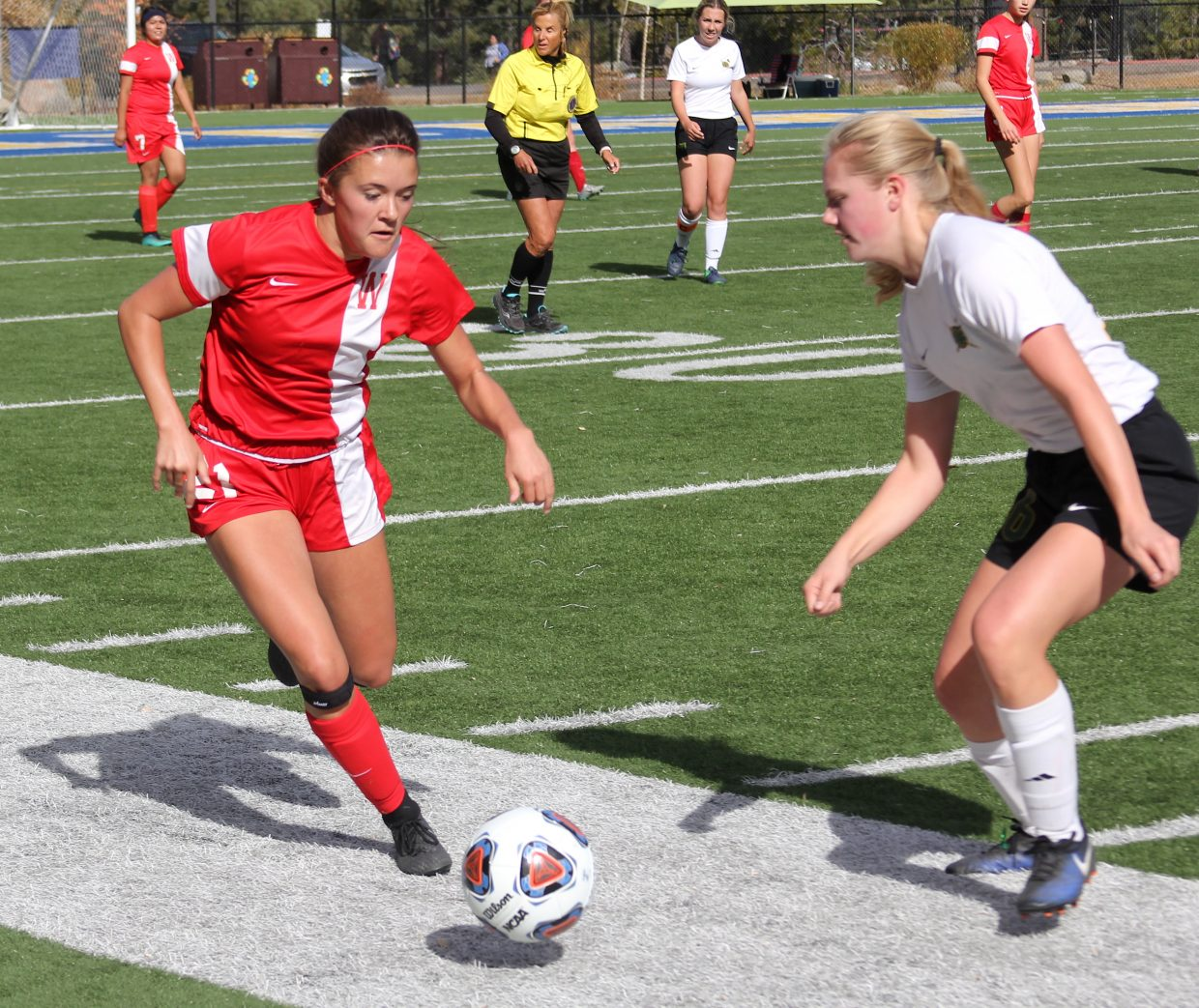 Whittell senior Anna White drives upfield.