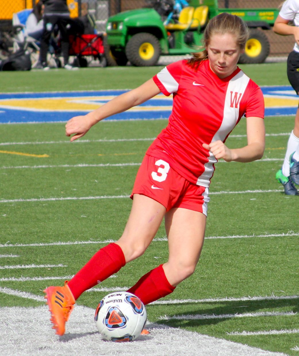 Whittell sophomore Ava Campbell uses fancy footwork to get past a defender.