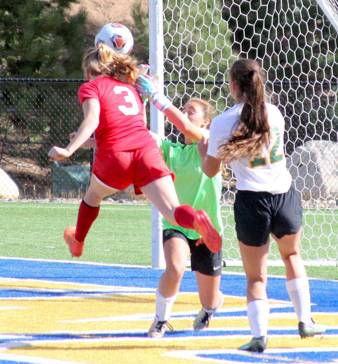 Whittell's Ava Campbell scores the Warriors goal Thursday late in the first half tie to the game with Incline.