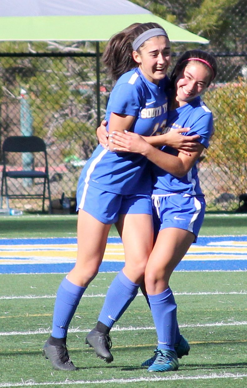 Giovana De Loia and a teammate celebrate De Loia's second half goal to tie the game.