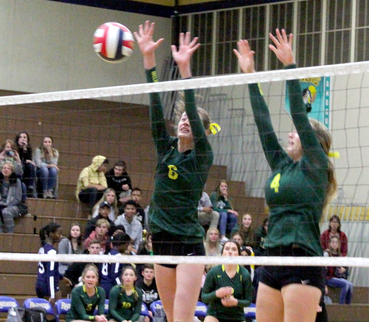 Brook Gutheil and Chandler Cohn (4) attempt to block a Meadows attack.