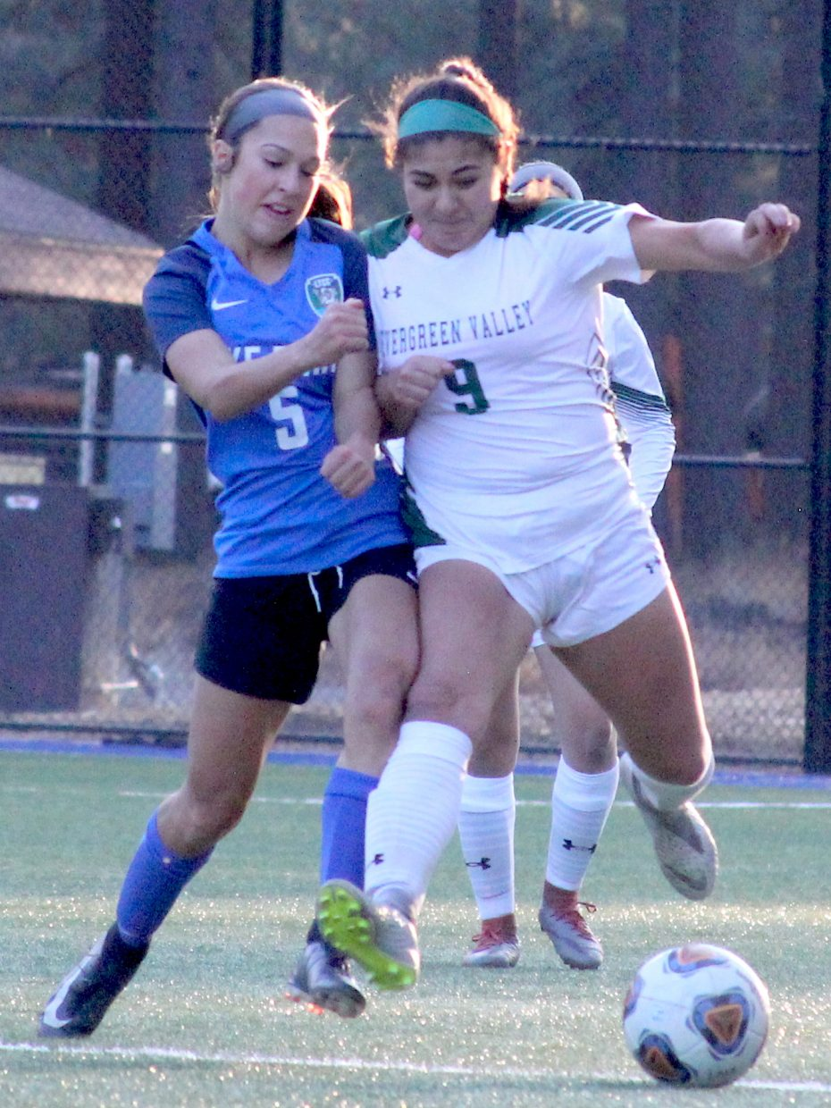 Lake Tahoe's Isabella Wakeling battles for possession Saturday against Evergreen Valley.