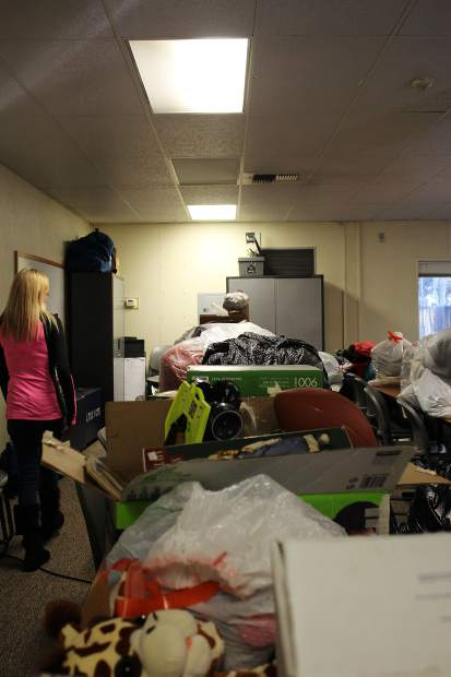 South Shore resident Jamie Sessions takes stock of the donations compiled at the Lake Valley fire station in Meyers.