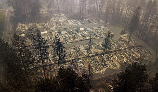 Residences leveled by the wildfire line a neighborhood in Paradise, Calif.