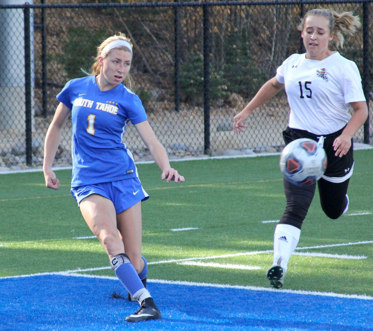 South Tahoe senior Lillie McGuire passes into the box.