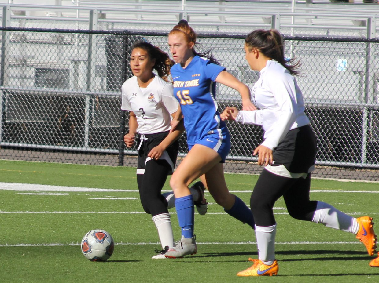 South Tahoe's Kelsey Hogan maintains possession under defensive pressure.