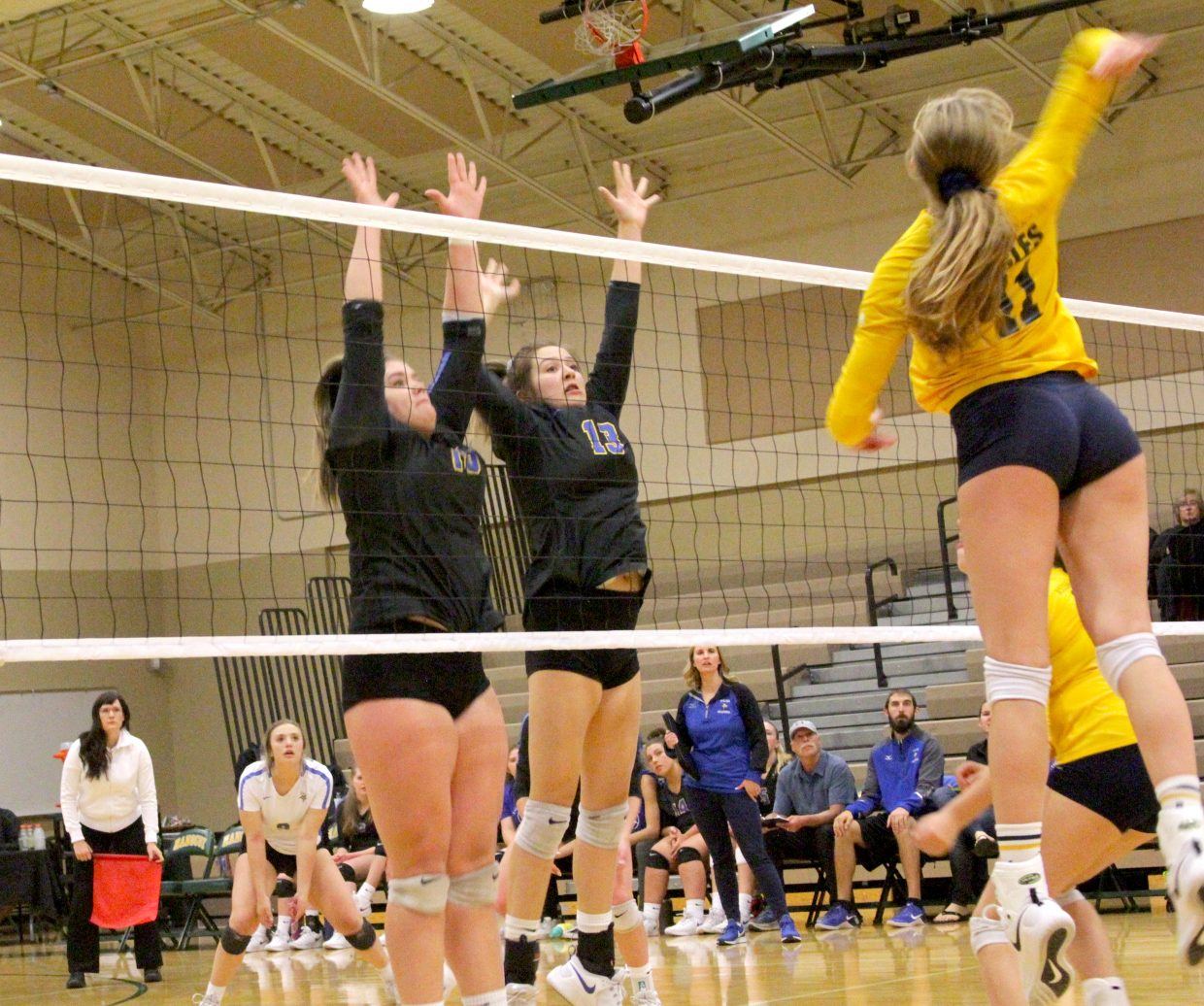 South Tahoe's Layne Hembree (left) and Jordan Malkus try for a block.