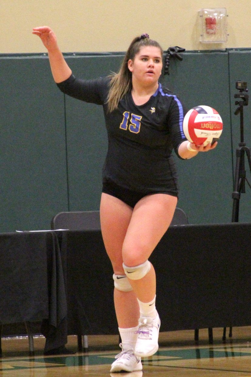 South Tahoe senior Layne Hembree prepares to serve Friday against Boulder City.