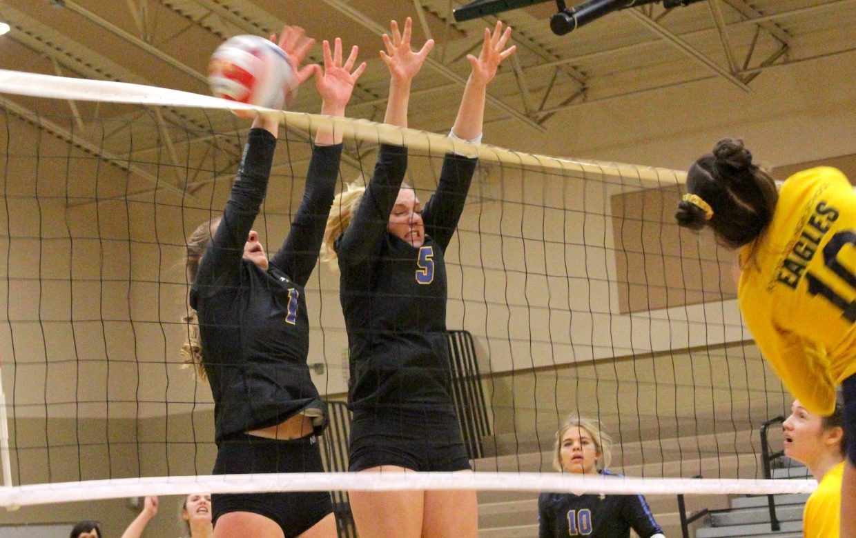 South Tahoe's Tyler Pevenage and Jerra McLaughlin go for a block Friday against Boulder City.