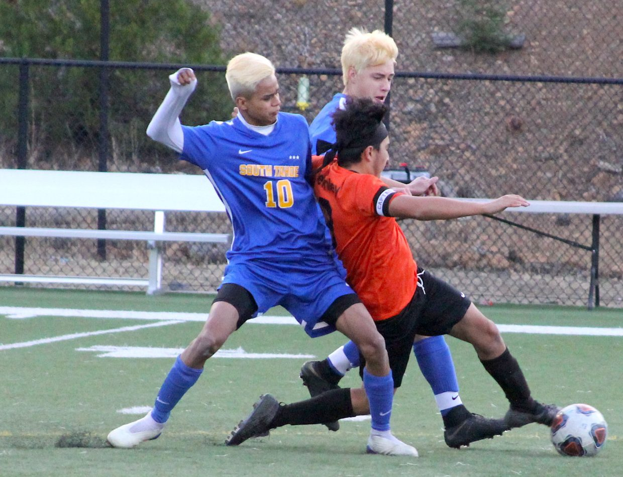 South Tahoe's Danny Hernandez and Oscar Marzocco pressure a Fernley player.