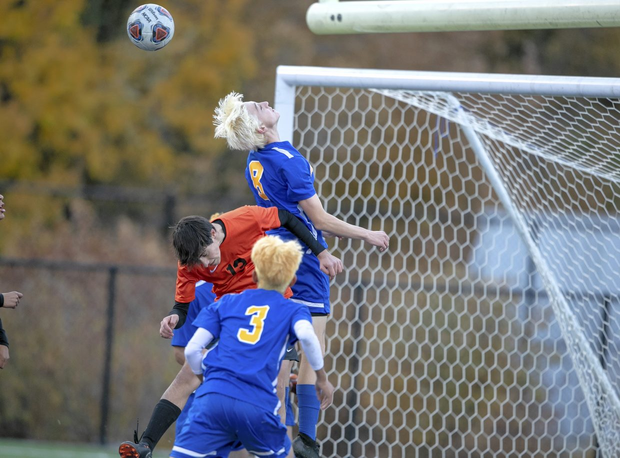 South tahoe's Josh Bull goes up for a header during a corner kick.