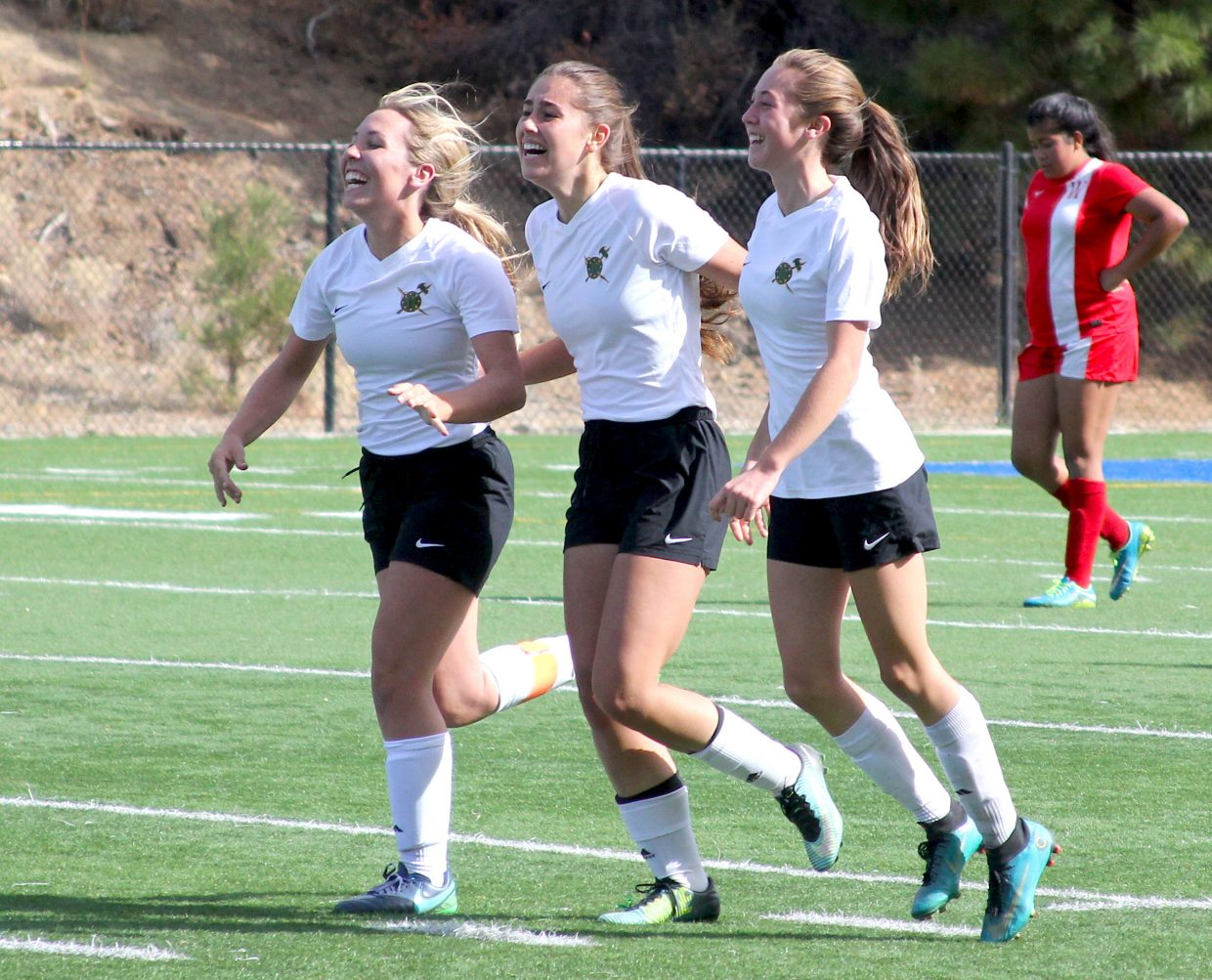Incline's (from left) Lauren Golden, Sami Giangreco and Haley Miller celebrate Giangreco's game-winning goal in the final moments.