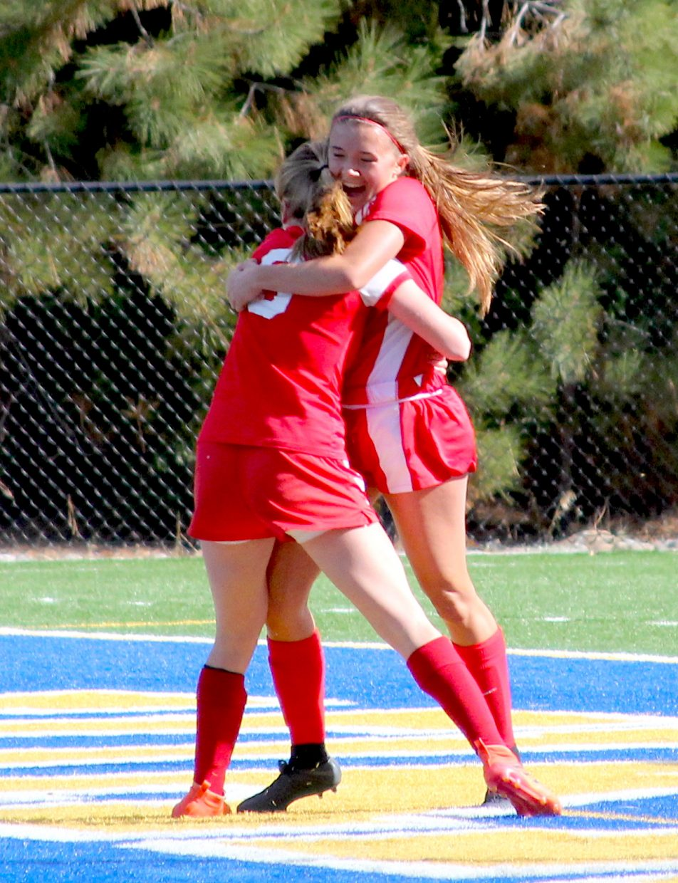 Ava Campbell and Anna White celebrate Campbells' first half goal Thursday against Incline.