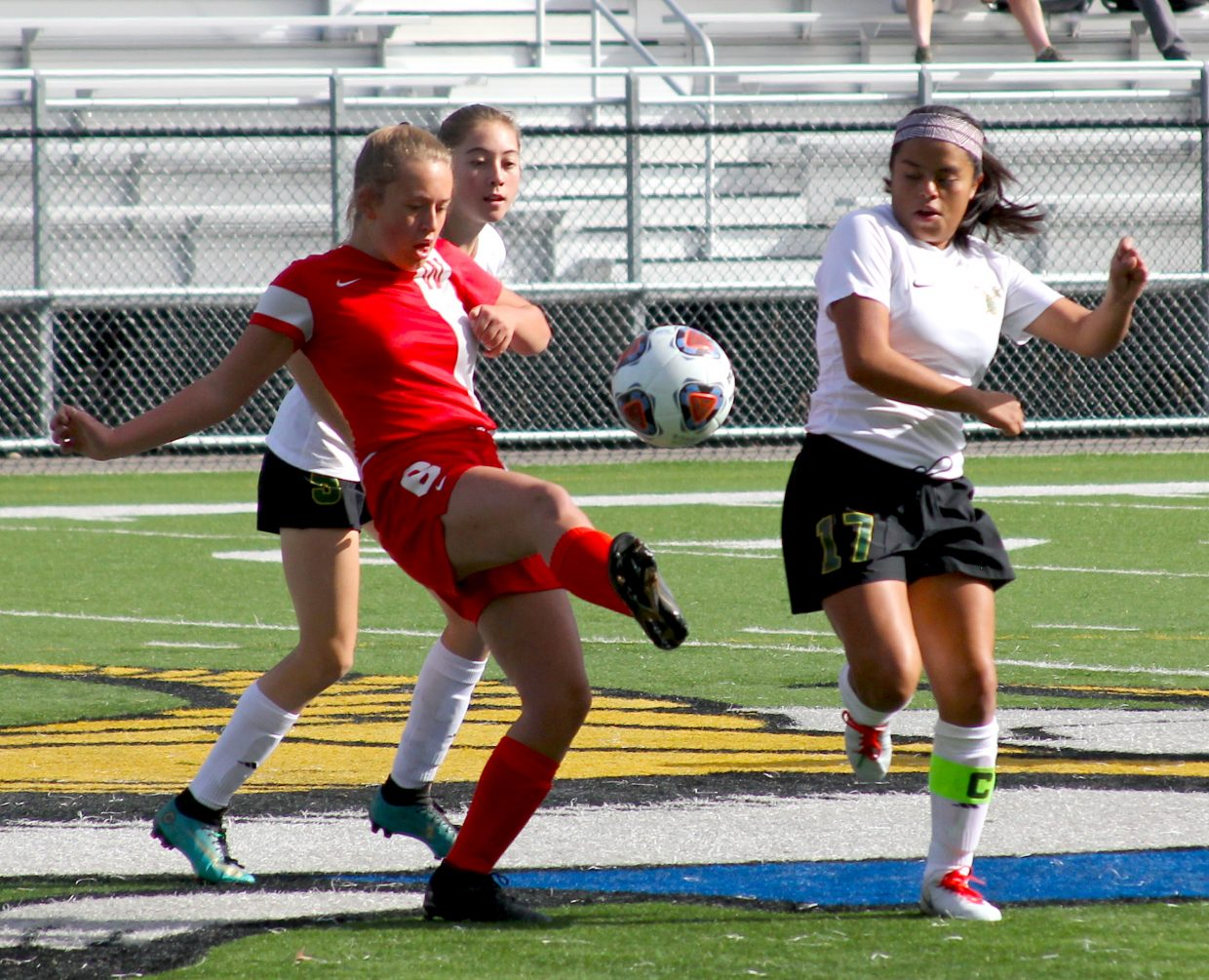 Whittell's Brianna Johns boots th eball upfield Thursday against Incline.