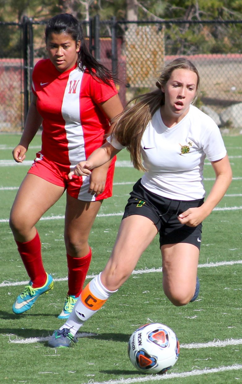 Incline's Lauren Golden chases possession Thursday against Whittell.