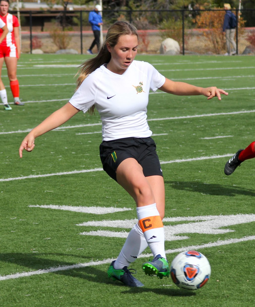 Incline co-captain Lauren Golden makes a pass.