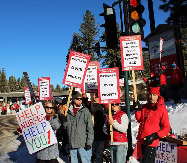 Demonstrators, who were demanding better benefits and work conditions for Barton Health nurses, sold baked goods while waving at traffic Monday morning in South Lake Tahoe.