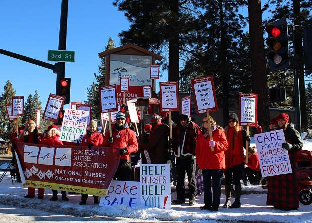 Local nurses protest at the corner of Lake Tahoe Boulevard and Third Street Monday morning.