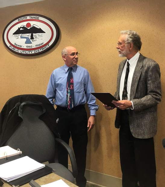 STPUD Board President Randy Vogelgesang, right, presents retiring GM RIchard Solbrig with a resolution recognizing his many years of service on Jan. 3.