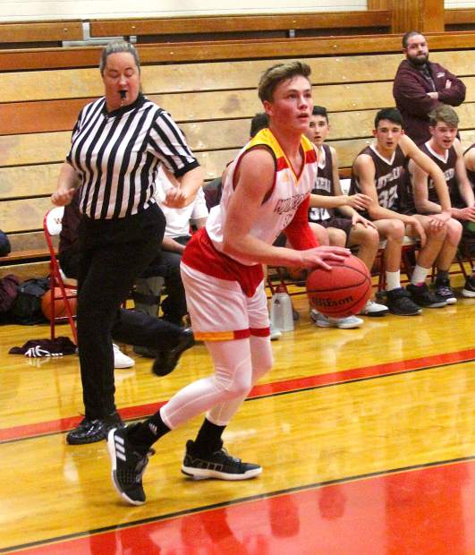 Whittell's Dylan Wade prepares to launch a 3-pointer.