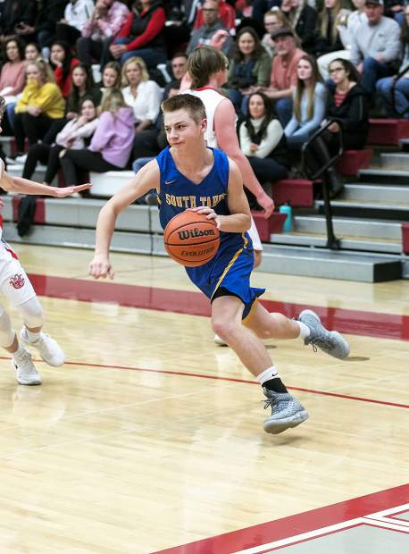 South Tahoe's Cameron Lehmann drives to the basket.
