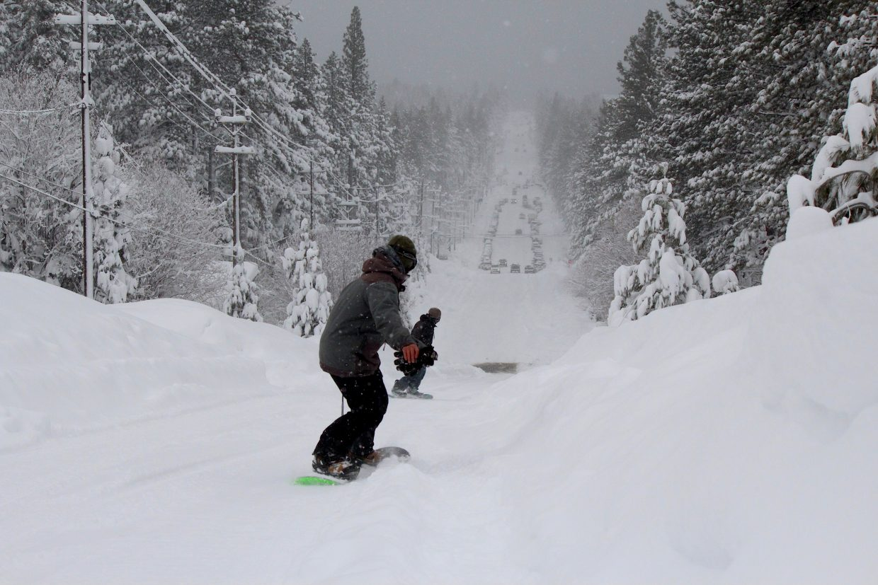 Two snowboarders make their way down Ski Run Boulevard Friday after hitting some runs at Heavenly Mountain Resort.