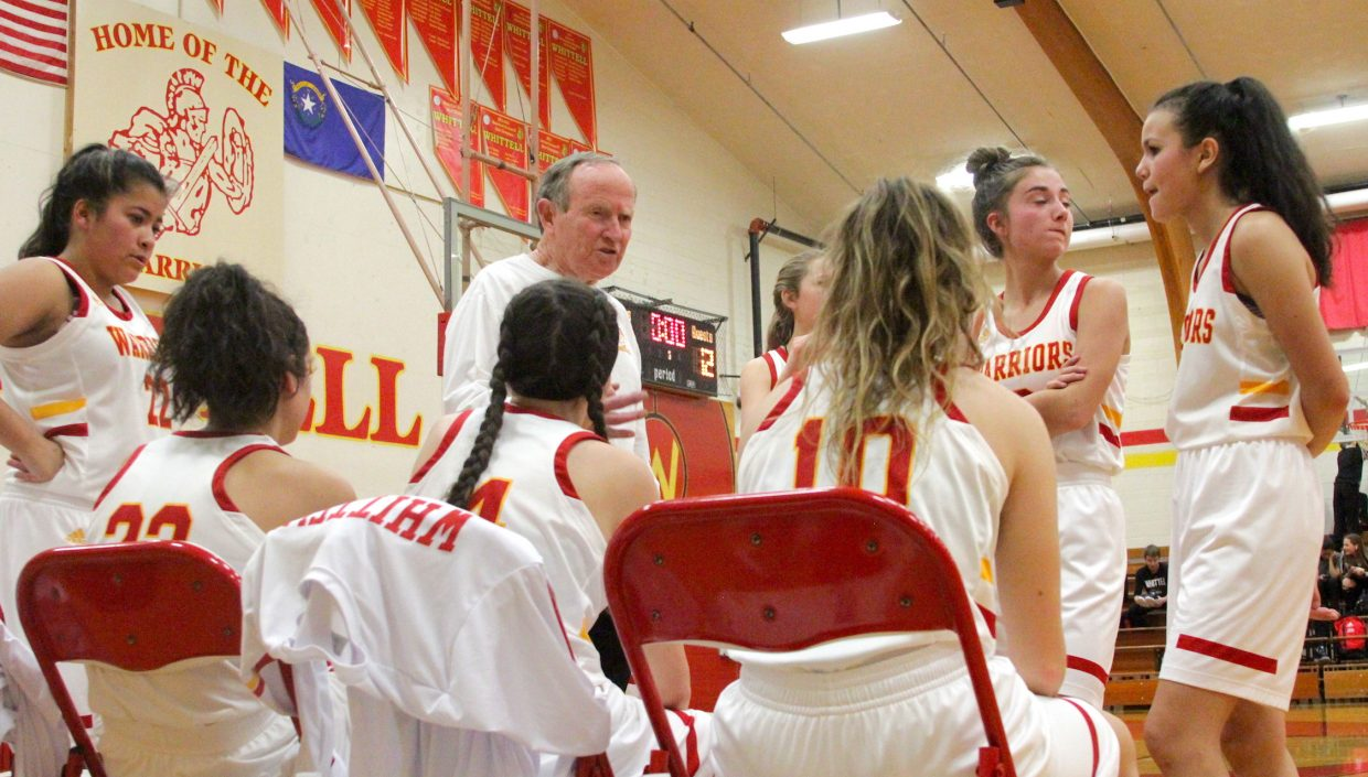 Whittell head coach Phil Bryant chats with his team during a break in the action.