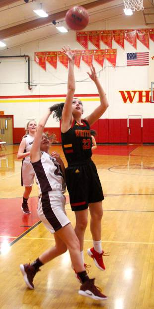 Whittell senior Madison Burch scores after grabbing an offensive rebound against Sage Ridge.