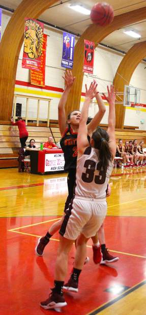 Whittell freshman Jessica Johnson shoots under pressure.