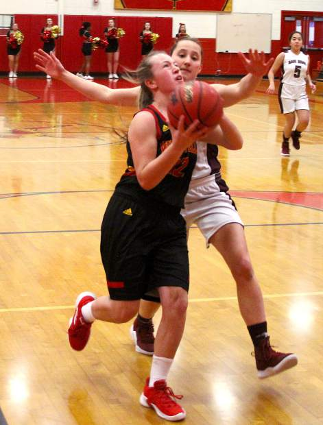 Whittell senior Brianna Johns scores the first two points of the game Tuesday against Sage Ridge.