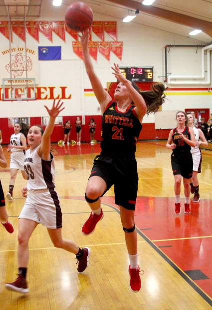 Whittell senior Anna White scores two of her game-high 13 points Tuesday against Sage Ridge.