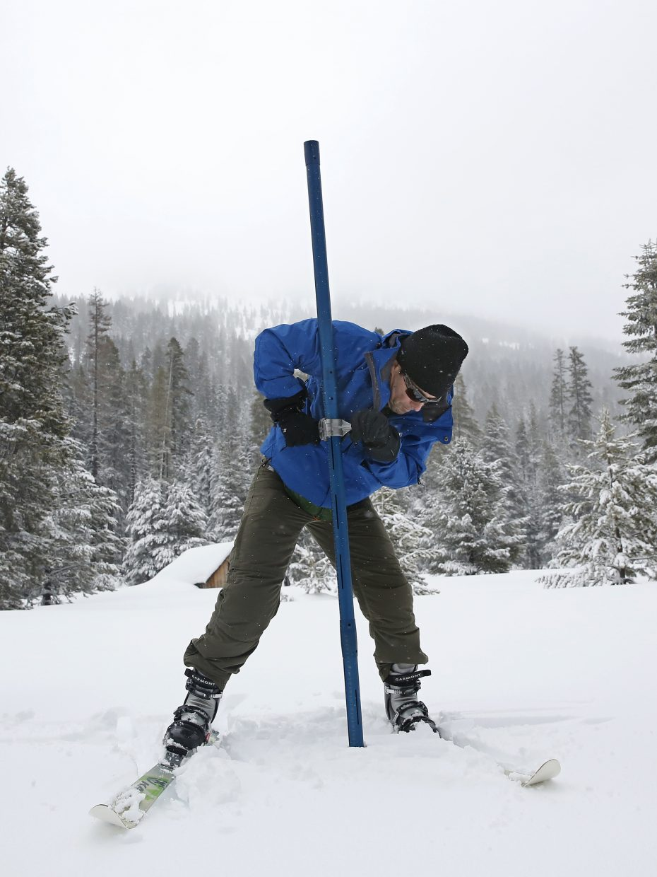 John King of the Department of Water Resources, thrust the snow survey tube into the snowpack while conducting the third manual snow survey of the season at the Phillips Station near Echo Summit, Calif., Thursday, Feb. 28, 2019. The survey found the snowpack at 113 inches deep with a snow water equivalent of 43.5 inches at this location at this time of year.