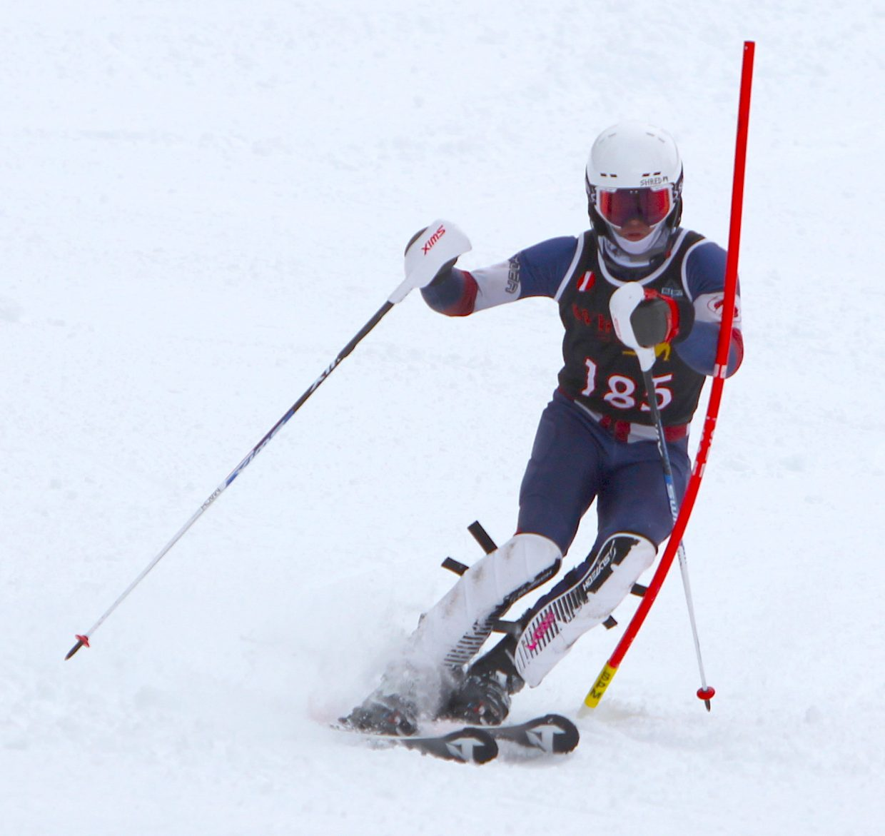 Whittell senior Gunnar Barnwell negotiates a gate during his first run Monday on his way to winning the alpine state slalom championship.