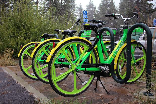 A rack of LimeBikes outside Tahoe Mountain Lab gets a light dusting of snow on Sept. 21.