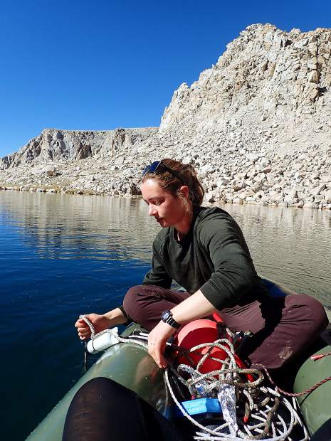 Adrienne Smits of UC Davis deploys a mooring in a Yosemite lake.