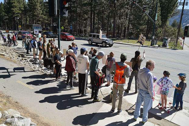 Marchers wait to cross Lake Tahoe Boulevard to Bijou Park. Around 50 people gathered at the Lakeview Commons during the third annual Earth Day Climate March on April 27.