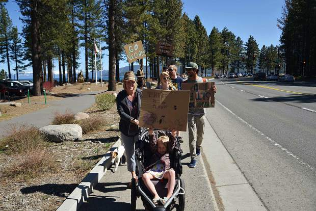 Jenny Hatch and her daughter Evelyn lead the procession of climate marchers to Bijou Park along Lake Tahoe Boulevard during the third annual Earth Day Climate March on April 27. Hatch is the executive director of the Sierra Nevada Alliance.