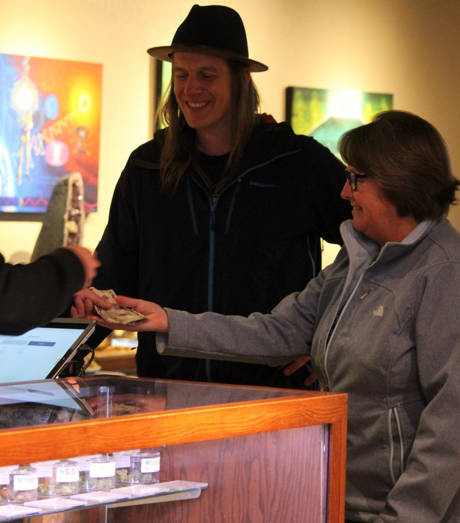 Mayor Brooke Laine makes the first legal adult-use cannabis purchase in South Lake Tahoe at Tahoe Wellness Cooperative Thursday, April 11. To the left is Cody Bass, Tahoe Wellness owner and South Lake Tahoe city councilor.