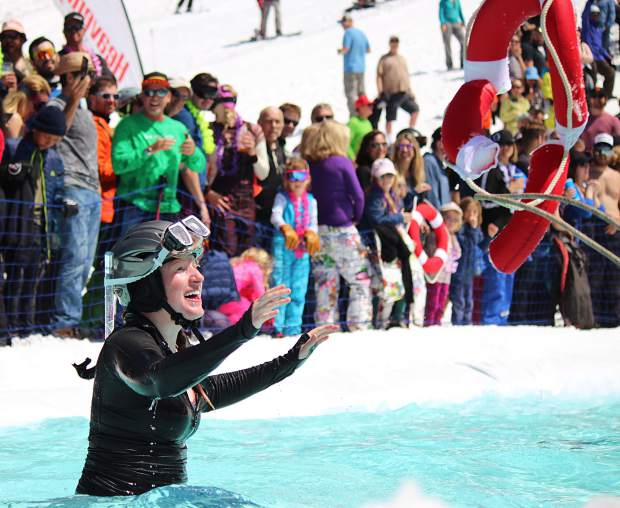 A competitor prepares to catch a buoy after wiping out during the pond skim at Heavenly Saturday, April 13.