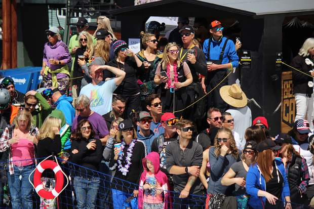 A lively crowd cheers on competitors at the 2019 pond skim at Heavenly Mountain Resort.