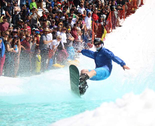 A competitor enters the pond at Heavenly Mountain Resort.