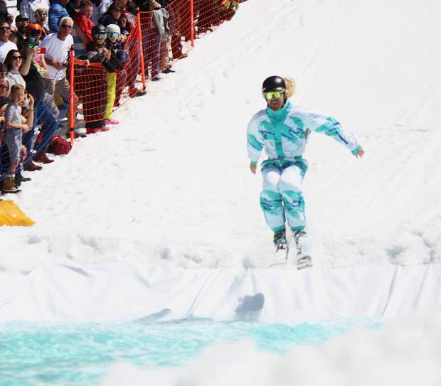 A skier enters the pond at Heavenly Mountain Resort.