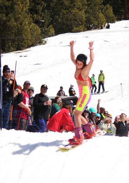 A snowboarder gives a thumbs-up after making it across the pond Saturday.