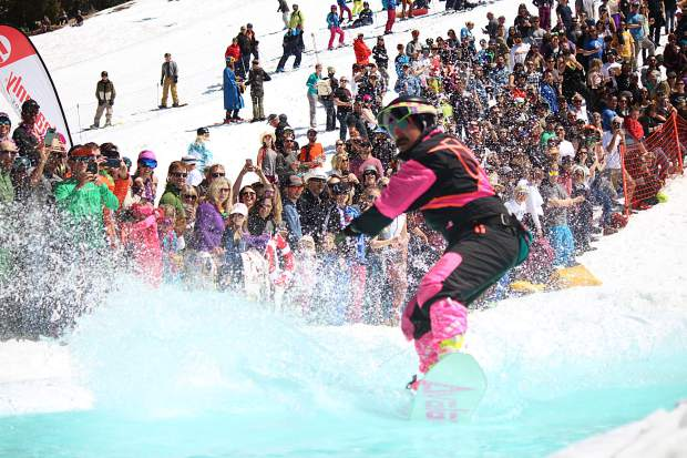 A competitor makes his way across the pond at the 2019 pond skim at the base of World Cup at Heavenly Mountain Resort on Saturday, April 13.