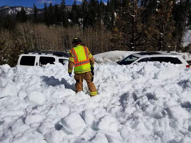 Two vehicles were caught in an avalanche on U.S. 50 Sunday, April 7.
