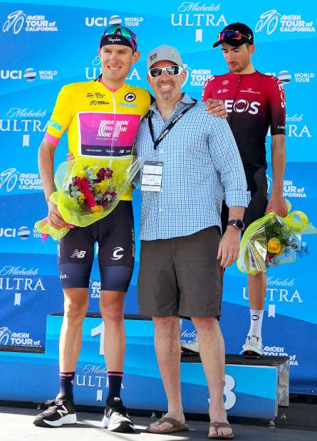 South Lake Tahoe City Councilor Jason Collin poses with Teejay van Garderen after rewarding him for finishing second in the stage and grabbing the overall race lead.