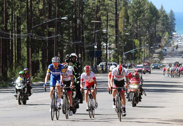 Kasper Asgreen, seen in blue, grinds his way up Ski Run Boulevard in South Lake Tahoe Monday, May 13, en route to winning stage 2 of the Amgen Tour of California. Asgreen is in third place behind Tejay van Garderen and Gianni Moscon heading into stage 3 of the race Tuesday.