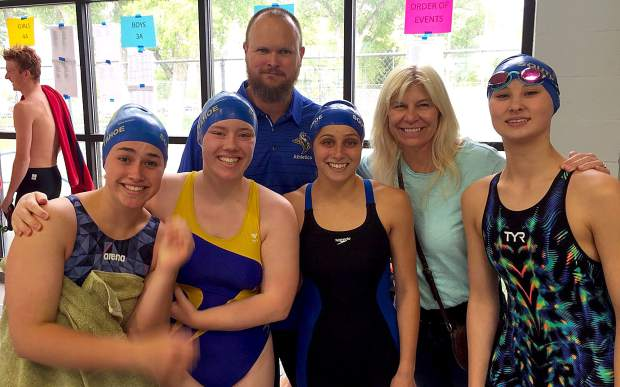 The South Tahoe girls' 400-yard freestyle relay team is (from left) Alexis Haven, Madelyn Evans, Hannah Lucas and Alex Otomo and are pictured with head coach Will Davenport and principal Carline Sinkler.