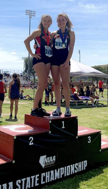 Whittell sprinters Kyla Rippett and Anna White stand on the podium after finishing first and second, respectively, in the 200-meter run.