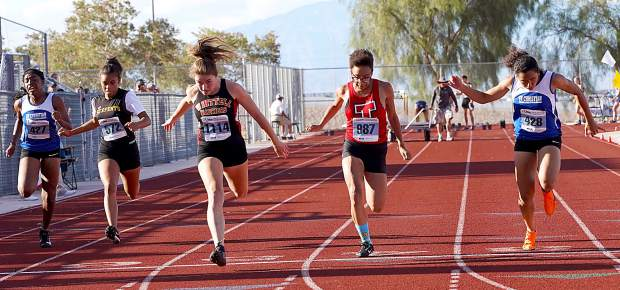 Whittell's Kyla Rippett wins the state championship in the 100-meter dash.